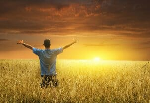 Recovery with the help of rehab depicted in this by man enjoying a sunset.